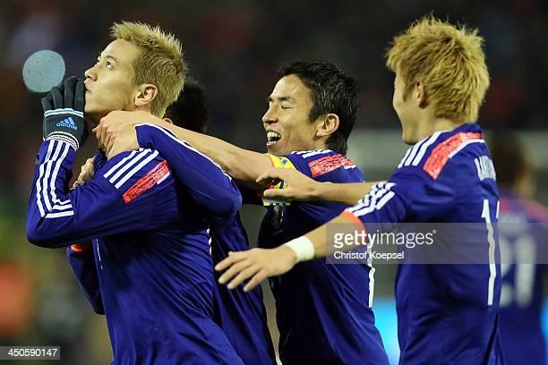 Keisuke Honda of Japan celebrates the second goal with Shinji Okazaki Makoto Hasebe of Japan and Yoichiro Kakitani during the international friendly...