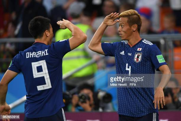 Keisuke Honda of Japan celebrates with team mate Shinji Okasaki after equalising during the 2018 FIFA World Cup Russia group H match between Japan...