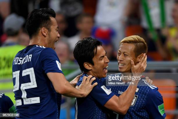 Keisuke Honda of Japan celebrates with teammate Makoto Hasebe of Japan and Maya Yoshida after scoring his team's second goal during the 2018 FIFA...