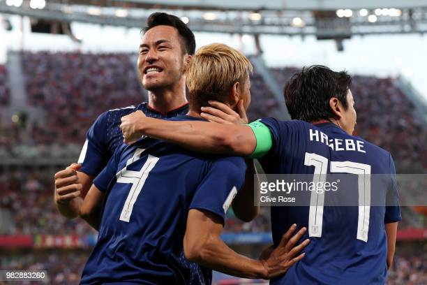 Keisuke Honda of Japan celebrates with teammate Maya Yoshida after scoring his team's second goal during the 2018 FIFA World Cup Russia group H match...