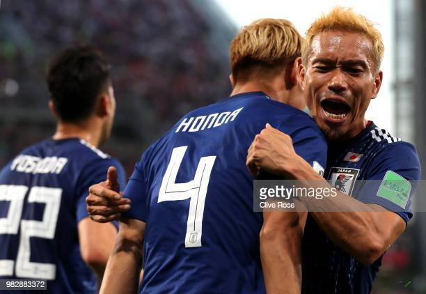 Keisuke Honda of Japan celebrates with teammate Yuto Nagatomo after scoring his team's second goal during the 2018 FIFA World Cup Russia group H...