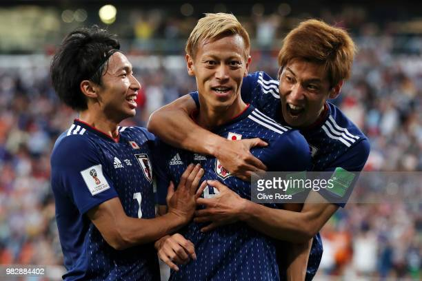 Keisuke Honda of Japan celebrates with teammate Yuya Osako after scoring his team's second goal during the 2018 FIFA World Cup Russia group H match...