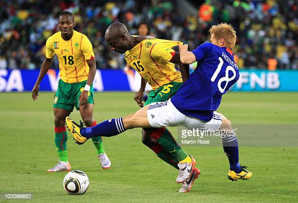 Keisuke Honda of Japan challenges Pierre Webo of Cameroon during the 2010 FIFA World Cup South Africa Group E match between Japan and Cameroon at the...