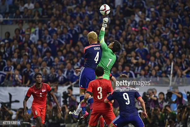 Keisuke Honda of Japan competes against Mohamad Izwan Bin Mahbud of Singapore during the 2018 FIFA World Cup Asian Qualifier second round match...