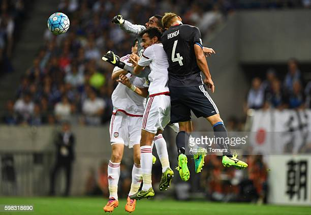 Keisuke Honda of Japan competes for the ball against UAE defense during the 2018 FIFA World Cup Qualifier Final Round Group B match between Japan and...