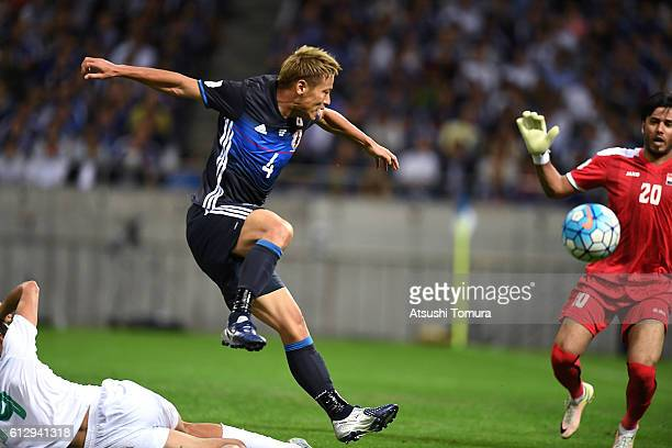 Keisuke Honda of Japan competes for the ball during the 2018 FIFA World Cup Qualifiers match between Japan and Iraq at Saitama Stadium on October 6...