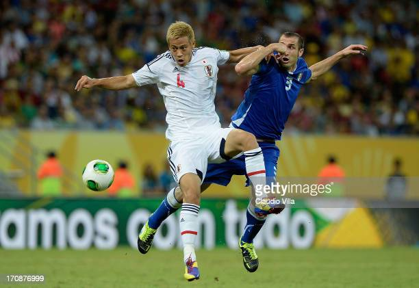 Keisuke Honda of Japan competes with Giorgio Chiellini of Italy during the FIFA Confederations Cup Brazil 2013 Group A match between Italy and Japan...