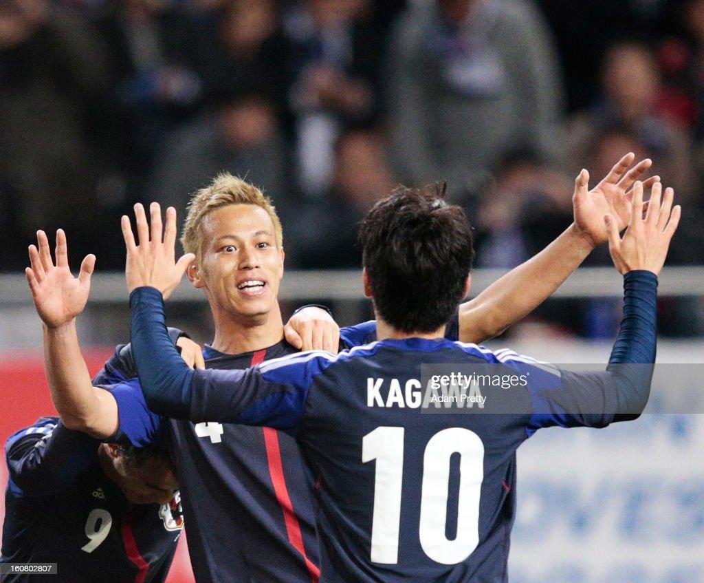Keisuke Honda of Japan is congratulated by Shinji Kagawa of Japan after scoring a goal during the international friendly match between Japan and Latvia at Home's Stadium Kobe on February 6, 2013 in Kobe, Japan.