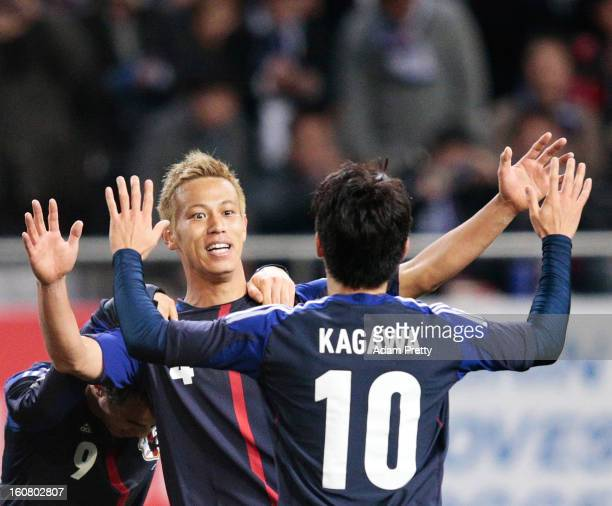 Keisuke Honda of Japan is congratulated by Shinji Kagawa of Japan after scoring a goal during the international friendly match between Japan and...