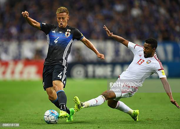 Keisuke Honda of Japan is tackled by Khamis Esmaeel of the United Arab Emirates during the 2018 FIFA World Cup Qualifier Final Round Group B match...