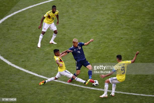 Keisuke Honda of Japan is tackled by Radamel Falcao and Wilmar Barrios of Colombia during the 2018 FIFA World Cup Russia group H match between...
