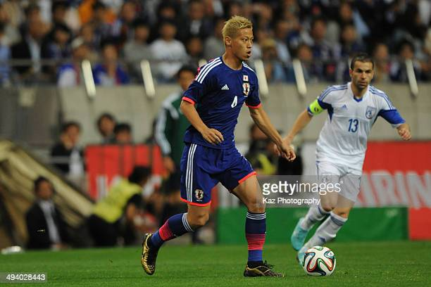 Keisuke Honda of Japan keeps the ball during the Kirin Challenge Cup international friendly match between Japan and Cyprus at Saitama Stadium on May...