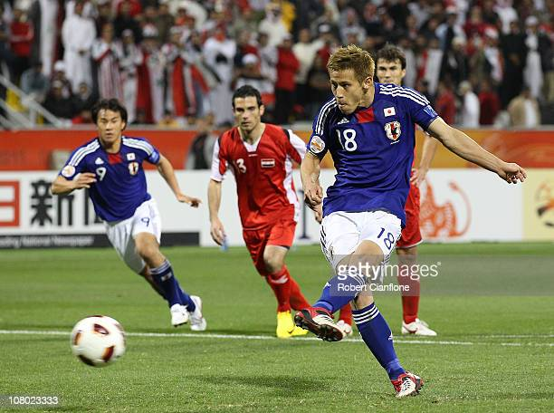 Keisuke Honda of Japan kicks his penalty for goal during the AFC Asian Cup Group B match between Syria and Japan at Qatar Sports Club Stadium on...