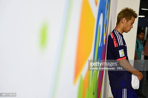 Keisuke Honda of Japan looks dejected in the tunnel after 14 defeat in the 2014 FIFA World Cup Brazil Group C match between Japan and Colombia at...