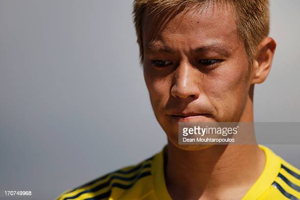 Keisuke Honda of Japan looks on after the Japan Training Session at the Confderations Cup at Centro de Capacitacao Fisica dos Bombeiros or Training...