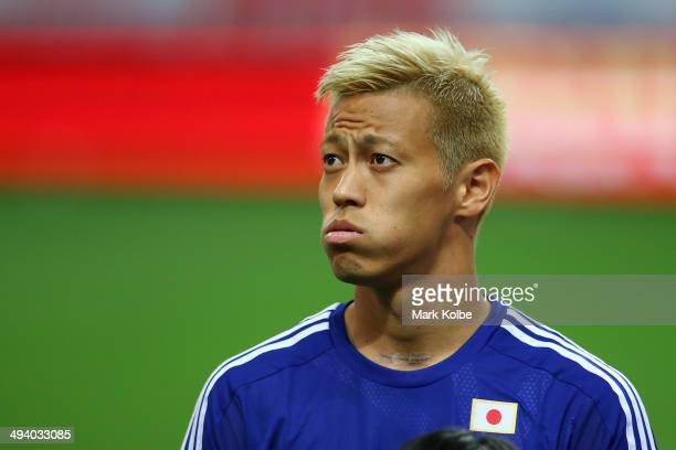 Keisuke Honda of Japan looks on during the anthems ahead of the Kirin Challenge Cup international friendly match between Japan and Cyprus at Saitama...