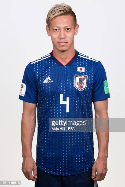 Keisuke Honda of Japan poses for a portrait during the official FIFA World Cup 2018 portrait session at the FC Rubin Training Grounds on June 14 2018...