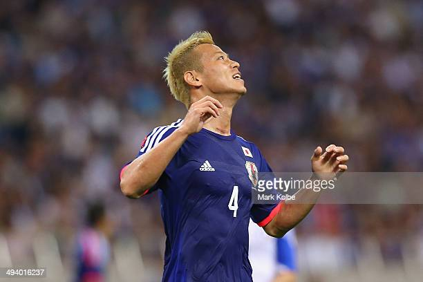 Keisuke Honda of Japan reacts after missed shot on goal during the Kirin Challenge Cup international friendly match between Japan and Cyprus at...