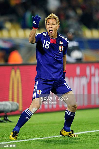 Keisuke Honda of Japan reacts during the 2010 FIFA World Cup South Africa Group E match between Denmark and Japan at the Royal Bafokeng Stadium on...