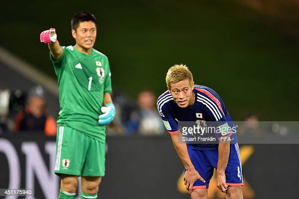 Keisuke Honda of Japan reacts during the 2014 FIFA World Cup Brazil Group C match between Japan and Colombia at Arena Pantanal on June 24 2014 in...