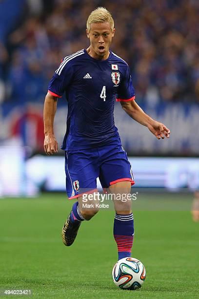 Keisuke Honda of Japan runs the ball during the Kirin Challenge Cup international friendly match between Japan and Cyprus at Saitama Stadium on May...