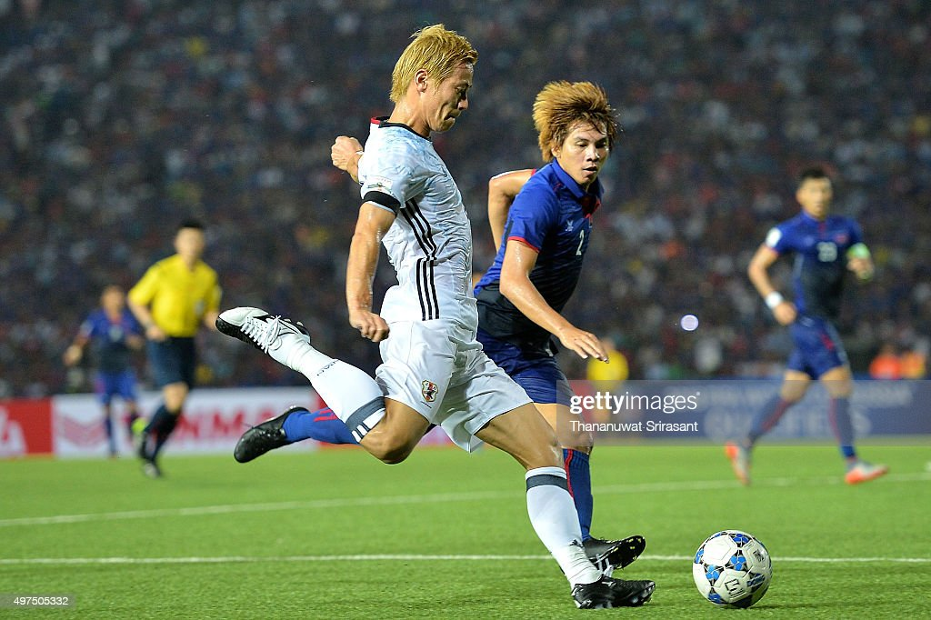 Keisuke Honda #4 of Japan runs with the ball during the 2018 FIFA World Cup Qualifier match between Cambodia and Japan on November 17, 2015 in Phnom Penh, Cambodia.