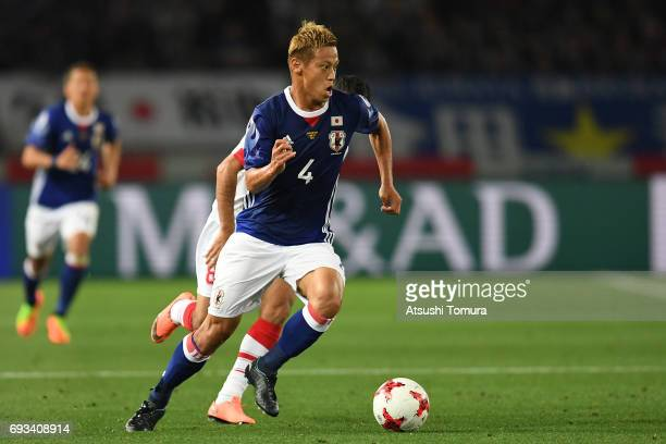 Keisuke Honda of Japan runs with the ball during the international friendly match between Japan and Syria at Tokyo Stadium on June 7 2017 in Chofu...