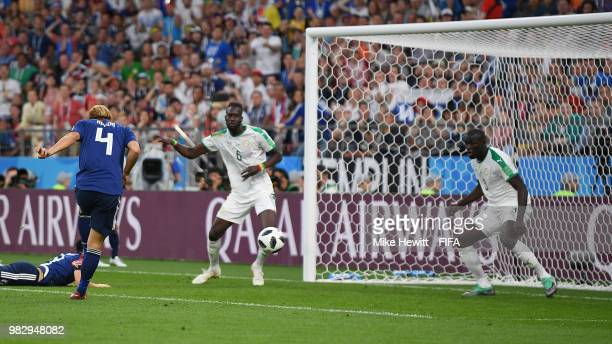 Keisuke Honda of Japan scores his side's equaliser during the 2018 FIFA World Cup Russia group H match between Japan and Senegal at Ekaterinburg...