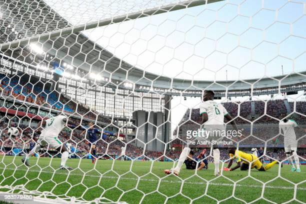 Keisuke Honda of Japan scores his side's second goal during the 2018 FIFA World Cup Russia group H match between Japan and Senegal at Ekaterinburg...