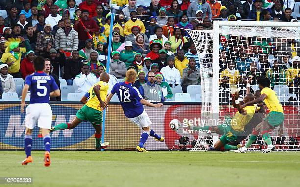 Keisuke Honda of Japan scores the first goal past Hamidou Souleymanou of Cameroon during the 2010 FIFA World Cup South Africa Group E match between...