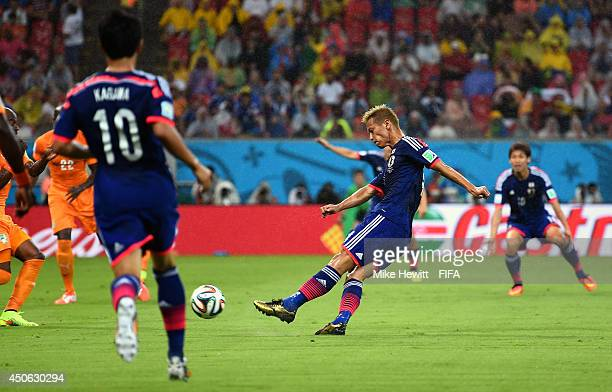 Keisuke Honda of Japan scores the opening goal during the 2014 FIFA World Cup Brazil Group C match between Cote D'Ivoire and Japan at Arena...