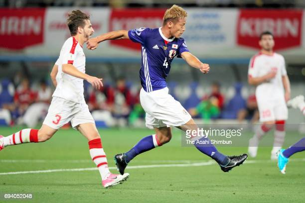 Keisuke Honda of Japan shoots at goal during the international friendly match between Japan and Syria at Tokyo Stadium on June 7 2017 in Chofu Tokyo...
