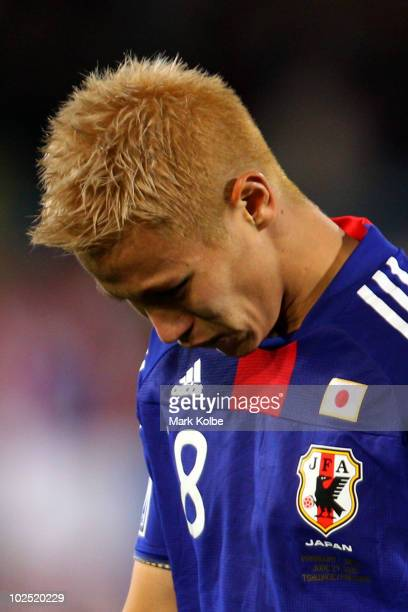 Keisuke Honda of Japan shows his dejection after losing a penalty shootout during the 2010 FIFA World Cup South Africa Round of Sixteen match between...