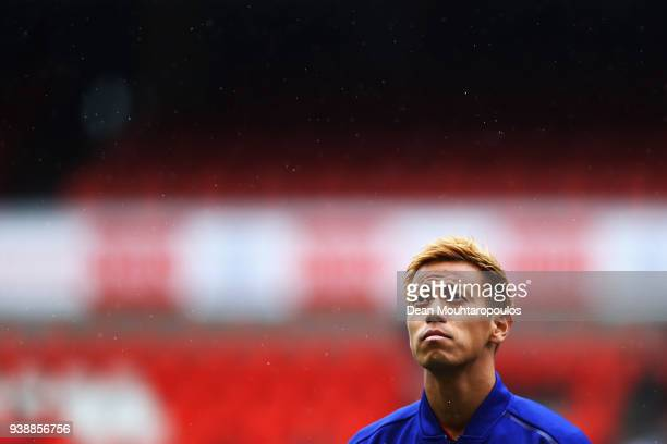 Keisuke Honda of Japan stands for the national anthem prior to the International friendly match between Japan and Ukraine held at Stade Maurice...