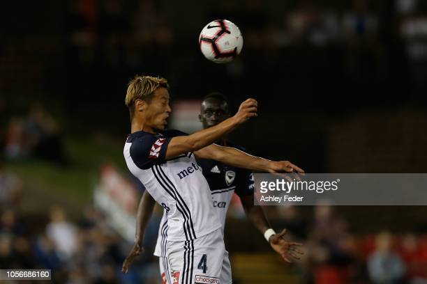 Keisuke Honda of Melbourne Victory heads the ball during the round three ALeague match between the Newcastle Jets and the Melbourne Victory at...