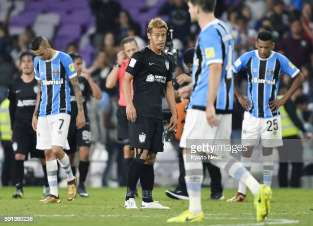 Keisuke Honda of Mexico's Pachuca looks dejected after a 10 extratime loss to Brazil's Gremio in their Club World Cup semifinal in Al Ain the United...