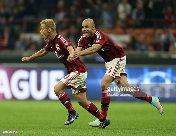 Keisuke Honda of Milan celebrates after scoring the second goal with his teammate Alex during the Serie A match between AC Milan and AC Chievo Verona...
