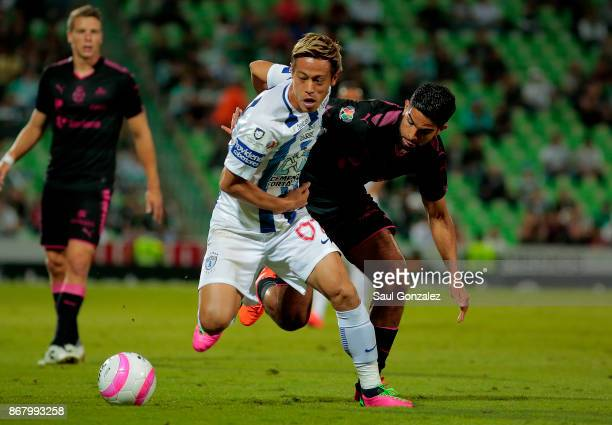 Keisuke Honda of Pachuca and Diego de Buen of Santos fight for the ball during the 15th round match between Santos Laguna and Pachuca as part of the...