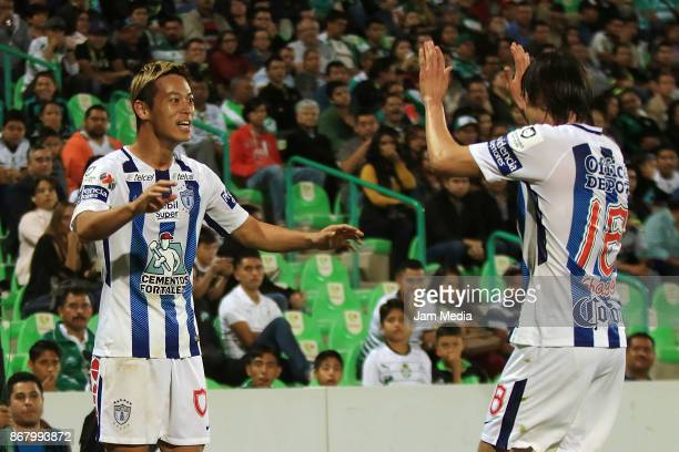 Keisuke Honda of Pachuca celebrates with teammate Jose Martinez after scoring the second goal of his team during the 15th round match between Santos...