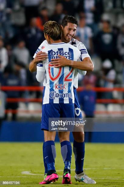 Keisuke Honda of Pachuca celebrates with teammate Omar Gonzalez after scoring the second goal of his team during the round of sixteen match between...