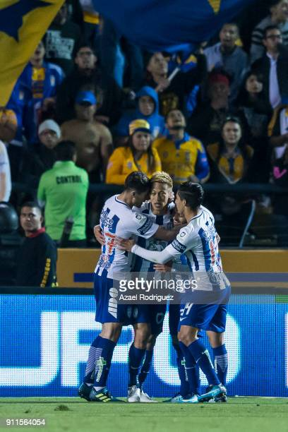 Keisuke Honda of Pachuca celebrates with teammates after scoring his team's second goal during the 4th round match between Tigres UANL and Pachuca as...