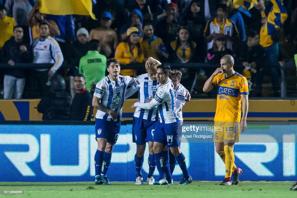 Keisuke Honda of Pachuca celebrates with teammates after scoring his team's second goal during the 4th round match between Tigres UANL and Pachuca as part of the Torneo Clausura 2018 Liga MX on January 27, 2018 in Monterrey, Mexico.