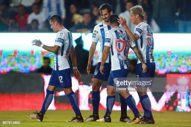 Keisuke Honda of Pachuca celebrates with teammates after scoring the fourth goal of his team during the sixth round match between Pachuca and...