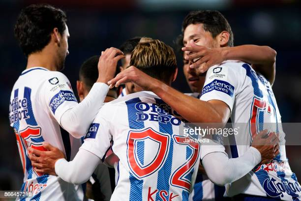 Keisuke Honda of Pachuca celebrates with teammates after scoring the second goal of his team during the round of sixteen match between Pachuca and...