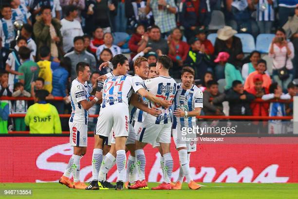 Keisuke Honda of Pachuca celebrates with teammates after scoring the first goal of his team during the 15th round match between Pachuca and Santos...