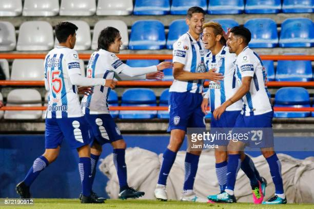 Keisuke Honda of Pachuca celebrates with tetammates after scoring his team's third goal during the quarter final match between Pachuca and Tijuana as...