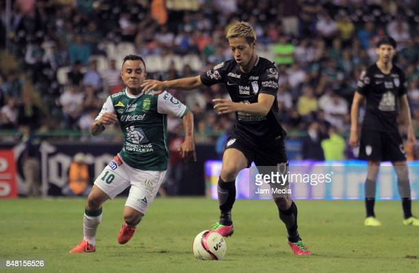 Keisuke Honda of Pachuca fights for the ball with Luis Montes of Leon during the 9th round match between Leon and Pachuca as part of the Torneo...