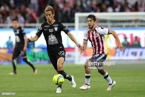 Keisuke Honda of Pachuca fights for the ball with Rodolfo Pizarro of Chivas during the 8th round match between Chivas and Pachuca as part of the...