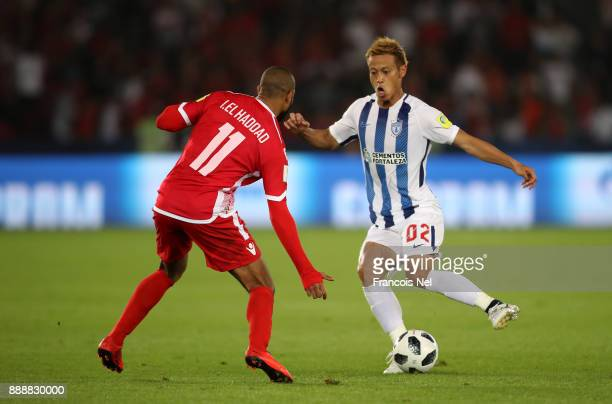 Keisuke Honda of Pachuca on the ball under pressure from Ismail Haddad of Wydad Casablanca during the FIFA Club World Cup match between CF Pachuca...