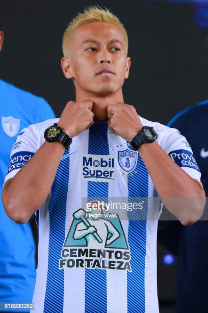 Keisuke Honda of Pachuca poses with his new jersey during a press conference to unveil Pachuca's new signings at Universidad del Futbol y Ciencias...